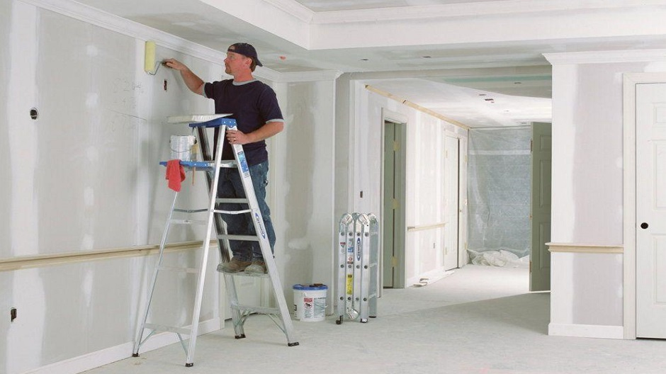 Pro painter using an aluminum step ladder