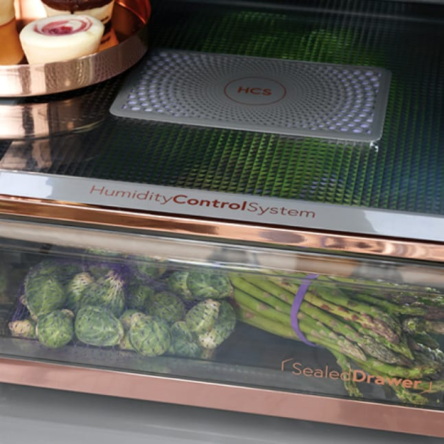 Humidity control drawer filled with vegetables.