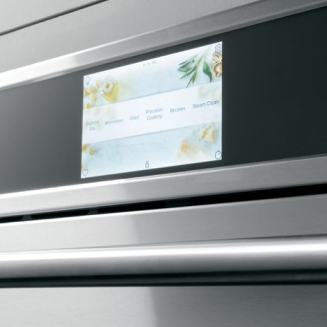 The wall LCD oven's screen shows a selection of options for cooking, baking, broiling, and more.