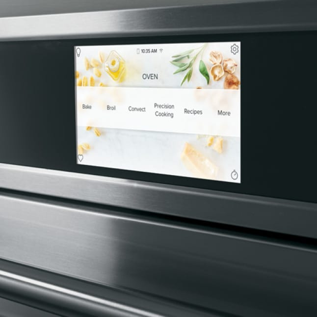 The wall oven's LCD screen shows a selection of options for cooking, baking, broiling, and more.