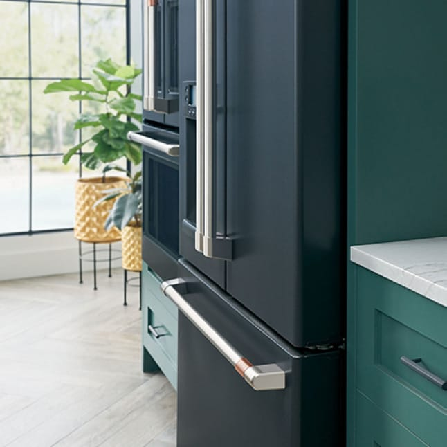 An installed fridge is flush with the surrounding cabinets, creating a seamless look.