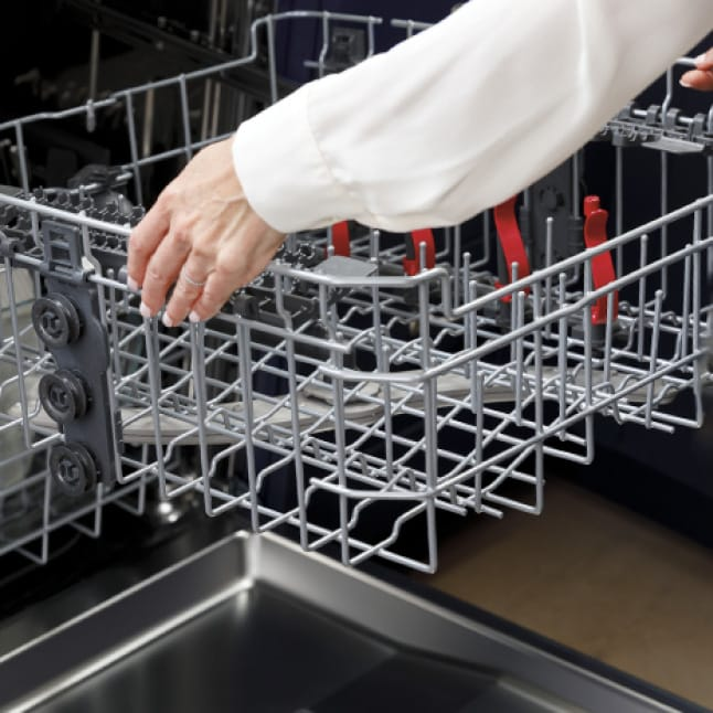 An icon of the dishwasher's interior.Arrows show the upper shelf being raised and lowered to fit large items on the upper and lower racks.