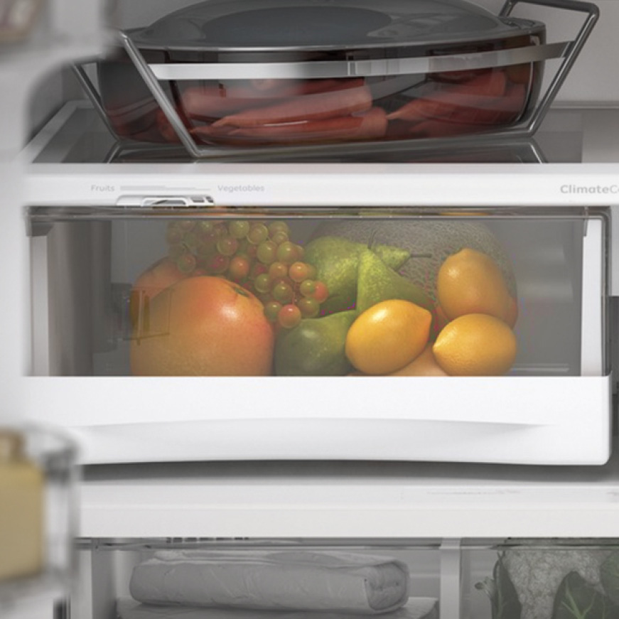 An assortment of fruit is contained inside of the specialized drawer
