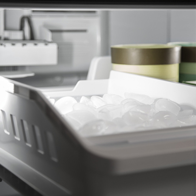 A bin in the freezer holds ice made by the ice-maker