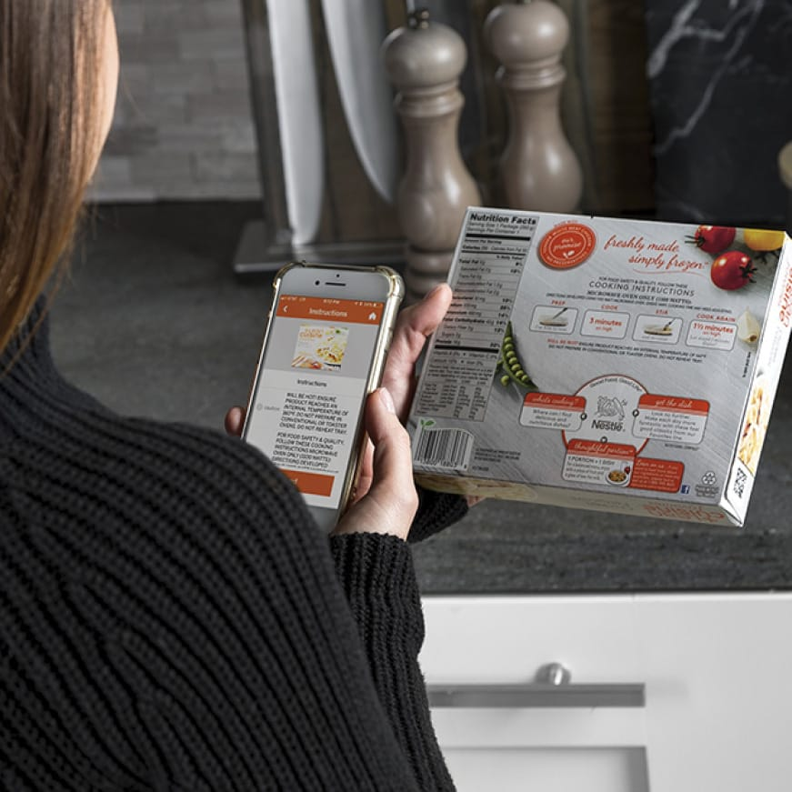 A woman scans her food with the smartphone app
