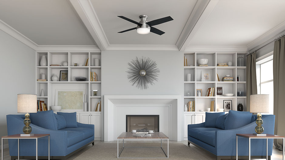 The Hunter Dempsey modern ceiling fan with lights in a modern living room.