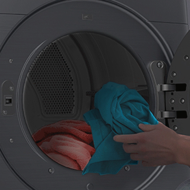 Close-up of open dryer door with hand pulling out an item of clothing and drum light turning on and off.