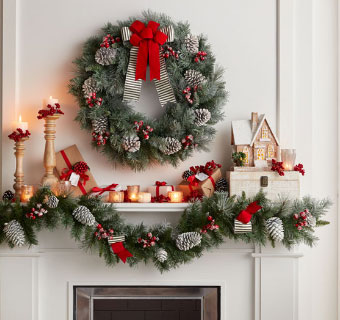 Mantle with greenery and wreath