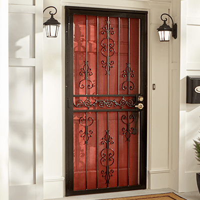 Ornate Iron Security Door Over A Red Front