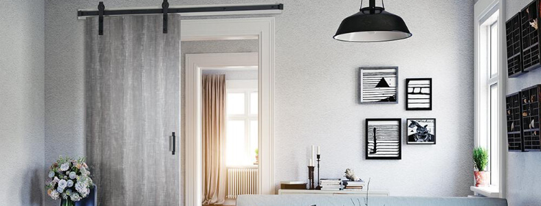 Light gray room with black accents and charred gray barn door