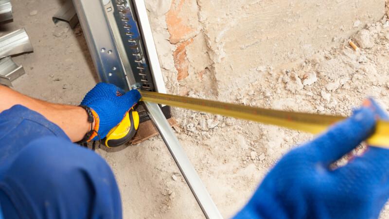 using tape measure on garage door frame