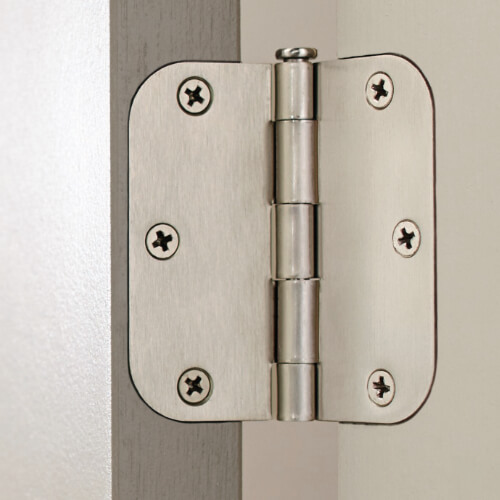 nickel hinge on gray door and white door jamb