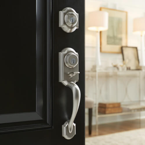 nickel handleset on black entry door