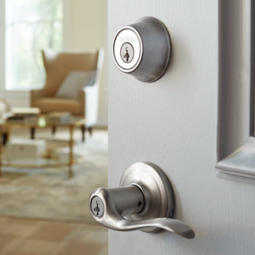lever and lock on light grey entry door