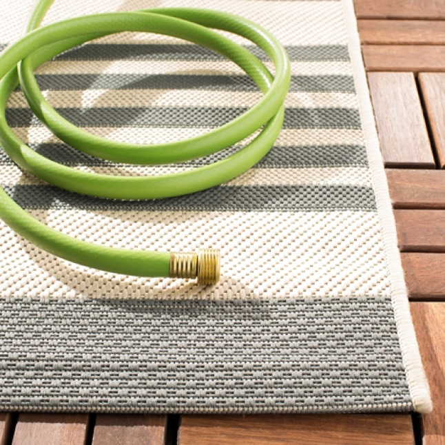 To clean an outdoor rug simply rinse with mild detergent and a garden hose and hang on a fence or railing to dry.