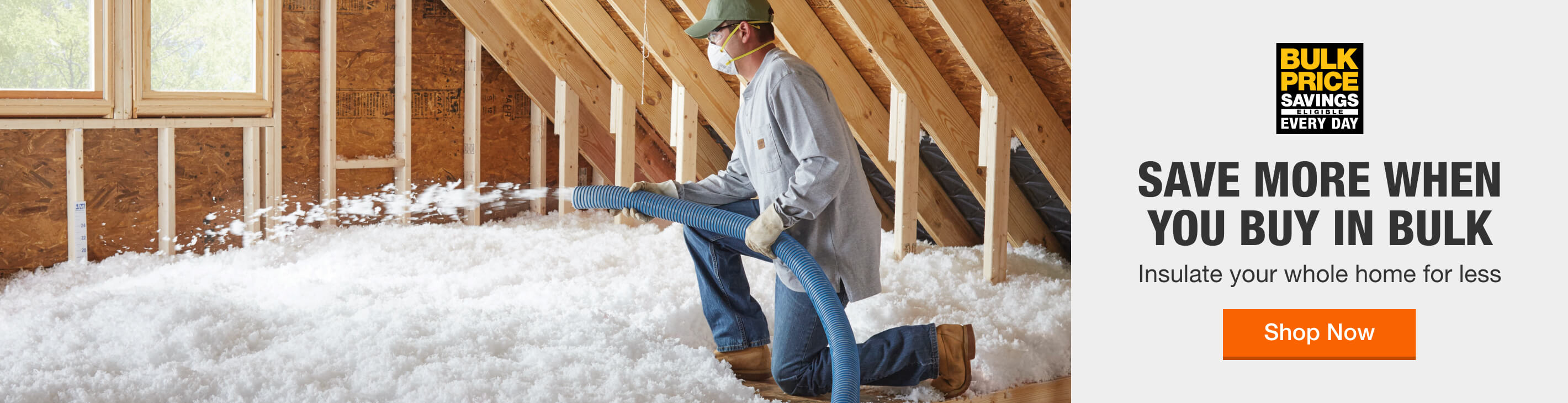 man blowing in insulation into attic