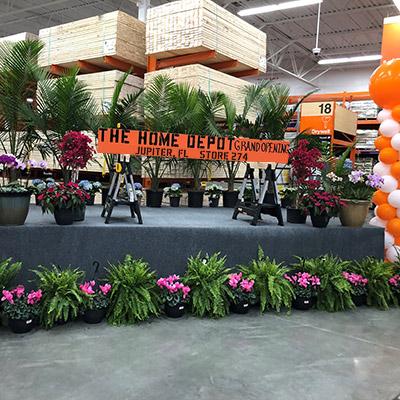 Orange slate of wood staged at Home Depot store entrance labeled Jupiter, fl store 274