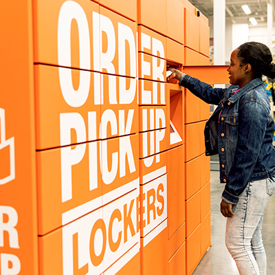 Woman pickup up order from Orange Home Depot Lockers