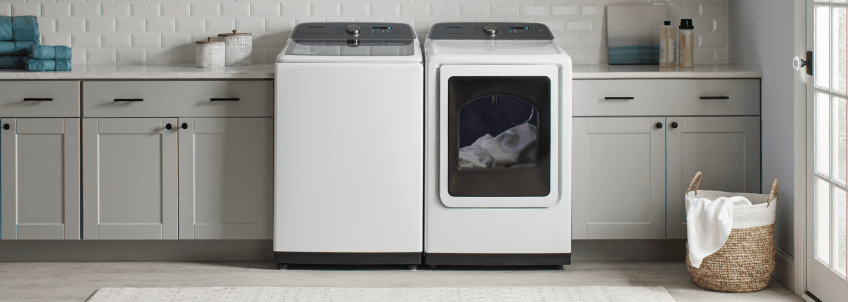 White Washer and Dryer Set in laundry room