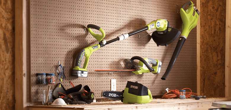 Several Ryobi power tools on shelf