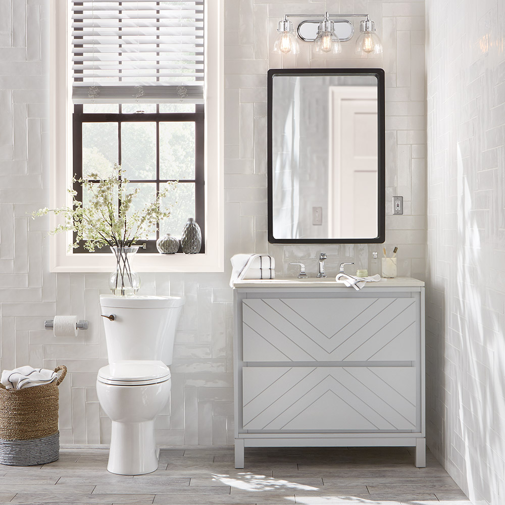 See how this gorgeous modern bathroom remodel incorporated elements from the Home Decorators Collection to tie neutral tones to rich layers of color.